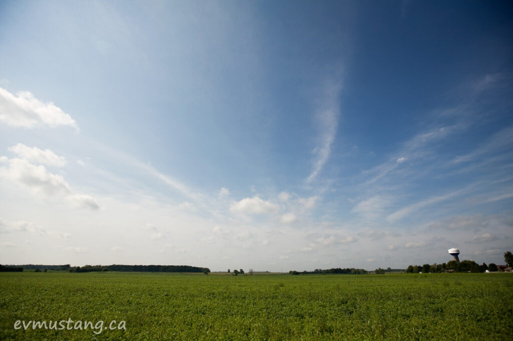 image of skyscape of thamesfod, ontario with pea field