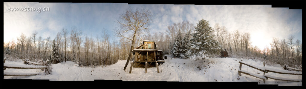 360° image of a cabin in the winter woods
