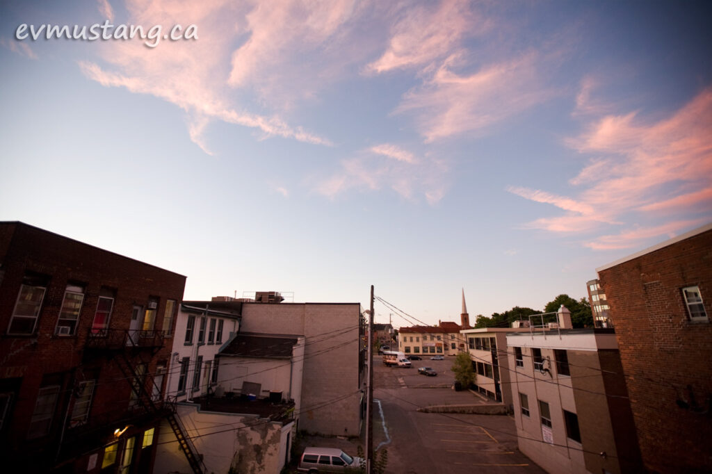 image of pink sunset clouds over alley in peterborough, onatio