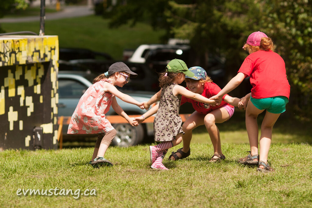 image of four girls playing and dancing at the peterborough folk festival