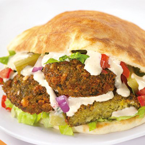 Enjoy falafels accompanied with a salad for a fun, healthy meal.