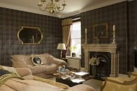 Image: Dark tartan wallpaper in country living room with