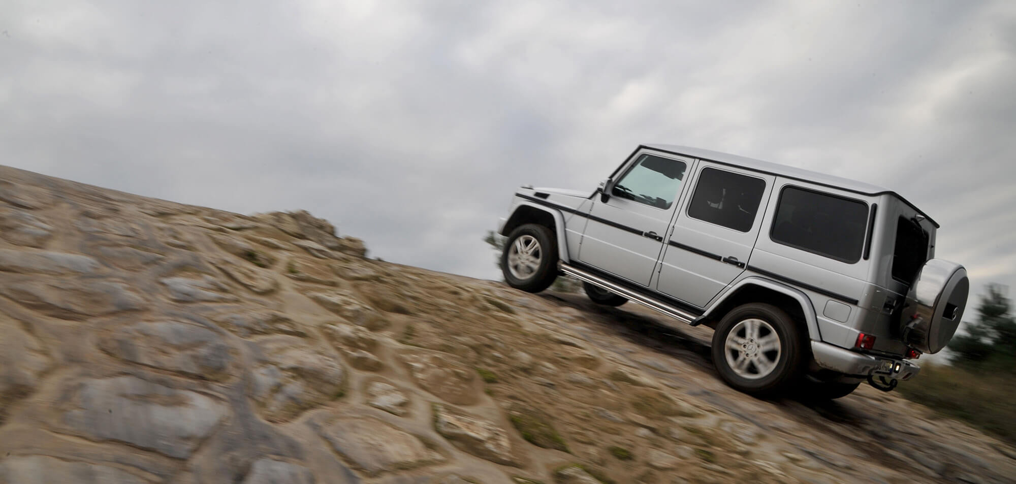 Mercedes G350 AMG G Wagon luxury hard core off road car on a steep slope - Exotic SUV