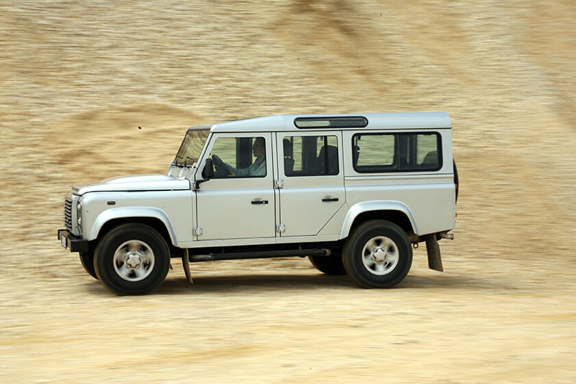 Land Rover Defender 110 TD4 Station SE, model year 2007-, silver, driving, side view, offroad. Image shot 2007. Exact date unknown.