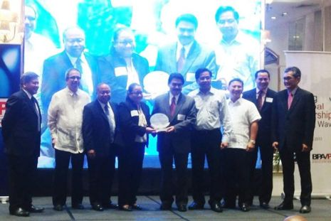Receiving plaque in behalf of the Bacolod-Negros Occidental Federation for ICT (BNEFIT) for Bacolod City as a Center of Excellence of Information Technology- Business Process Management for 2012 with DOST Secretary Mario Montejo. With Bacolod Mayor Bing and Roy Balicas, representative for Negros Occidental Governor Freddie Maranon. (From Atty. Batapa-Sigue's FB Page)