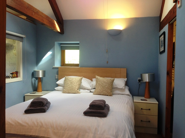 Bedroom with king size bed and en suite bathroom