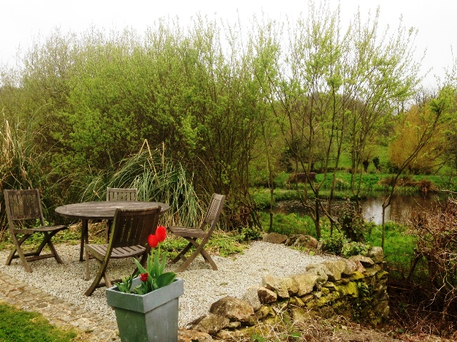 The Picnic Table and Chairs by the Pond