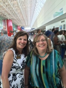 "Brenda Collins and Betty Russo at current exhibit entitled ""ART-chitecture."""
