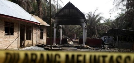 "Police tape blocks access to a burned church at Suka Makmur Village in Aceh Singkil, Indonesia Aceh province, October 18, 2015. The words on the tape read, ""Do not cross."" REUTERS/YT Haryono"