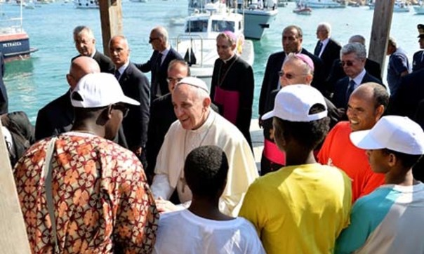 Pope Francis greets immigrants on the wharf of Lampedusa Harbor. At the time of his visiting, many of the refugees, virtually all Muslims had just began their fast for the feast of Ramadan.
