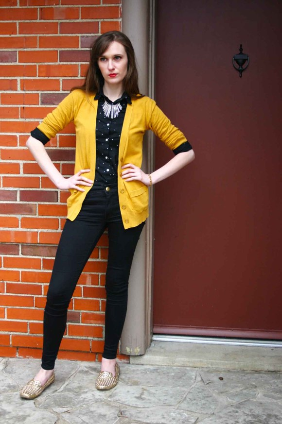 Emily from Fashion By Committee- Audaviv spike bangle, Target mustard cardigan, gold and black bib necklace, Old Navy polka dot button down blouse, American Eagle black skinny jeans, Bakers spiky gold flats