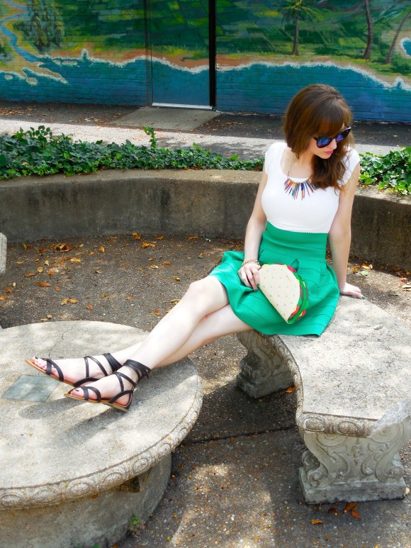 Emily from Fashion By Committee- Betsy Johnson taco clutch, H&M green skirt, Expess white tee, Call It Spring sunglasses, Target necklace and sandals