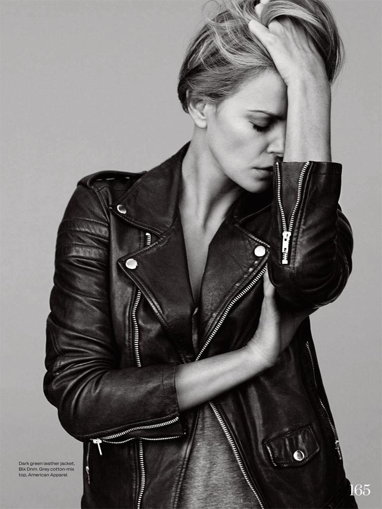 Charlize wears a leather jacket