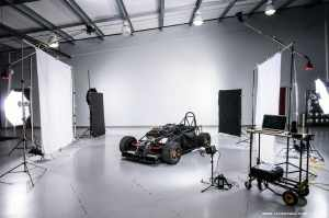 Behind the scenes set up for the studio car shots. 8 lights and 2 power packs.