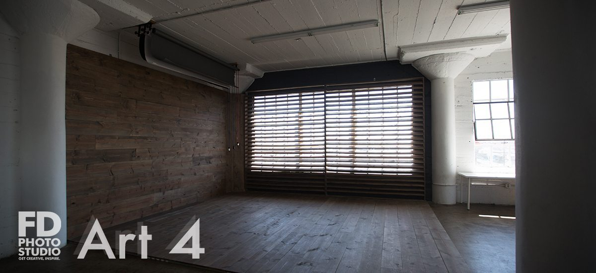 photo studio with wood wall and corner with large wood blinds