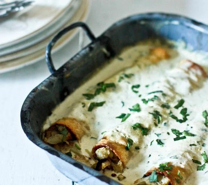 Roasted Poblano Enchiladas with Chicken or try cauliflower for a vegetarian option! | www.feastingathome.com