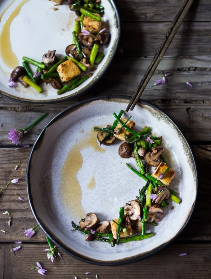 Wok seared asparagus and mushrooms with garlic, ginger and sesame...with crispy tofu- a vegan gluten free meal that can be made in 15 minutes flat!   www.feastingathome.com