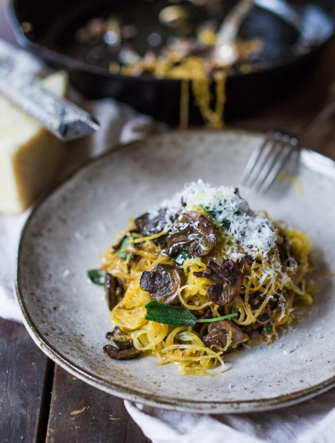Roasted Spaghetti Squash with mushrooms, garlic and sage- a flavorful side dish, perfect for fall. Keep it vegan or add grated Romano cheese  www.feastingathome.com