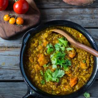 "Soulful, Comforting Lentil Dal with Sweet Potatoes and a flavorful ""tempering oil"". A quick 30 minute meal that is simple to make and full of fragrant Indian spices. Vegetarian 