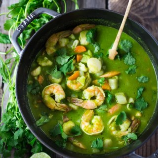 A delicious recipe for Peruvian Seafood Stew with Cilantro Broth, with potatoes and carrots. Healthy, Gluten free, Easy... and can be made in 35 minutes! | www.feastingathome.com