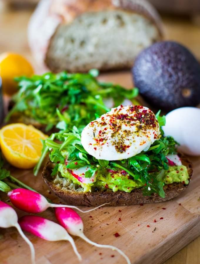 Avocado Toast with arugula, radish, poached #egglandsbest eggs and zataar spice! | ww.feastingathome.com