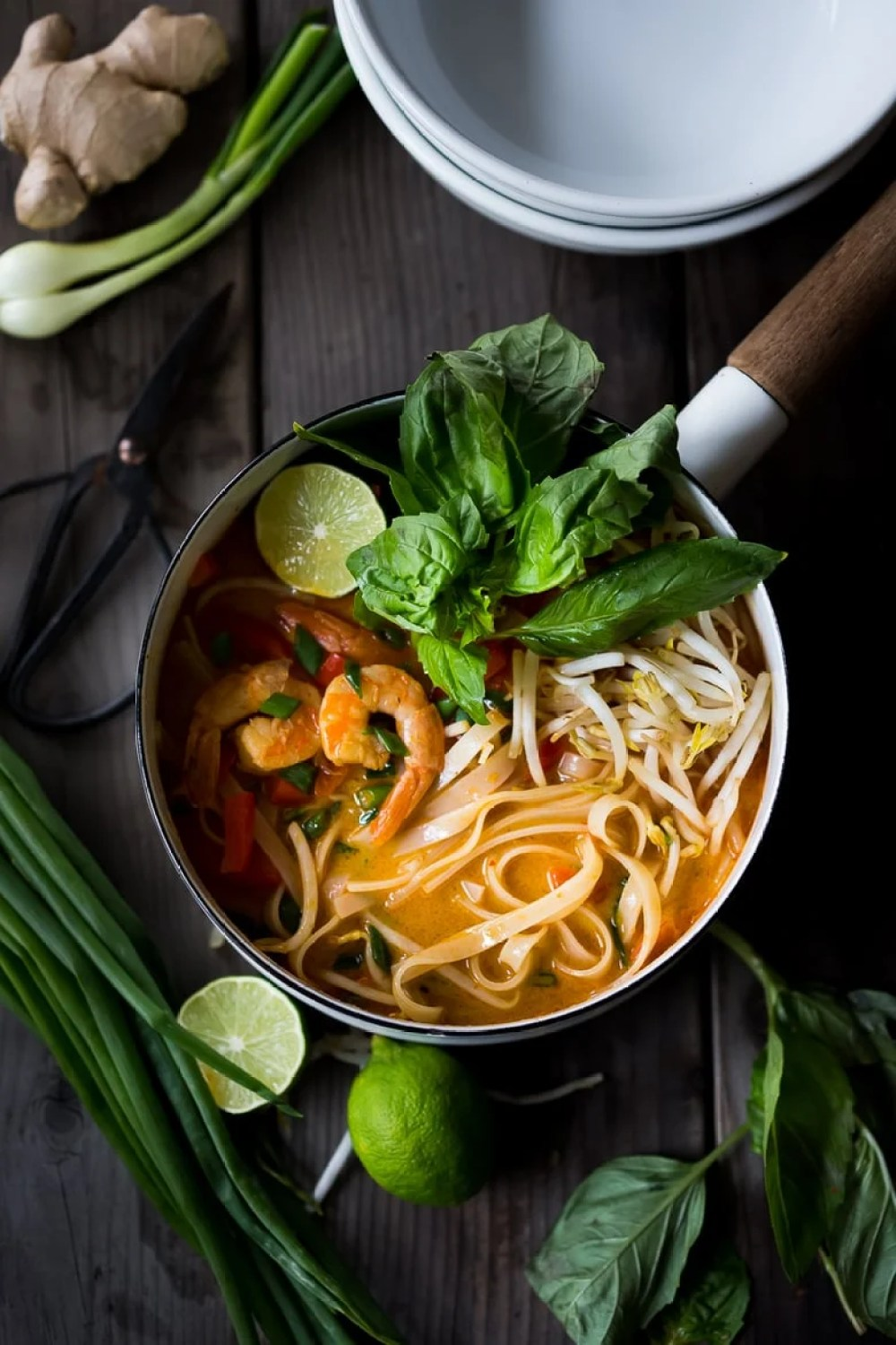 Fast and flavorful, this 15 Minute Northern Style, Thai Coconut Noodle Soup called, Khao Soi is so easy to make! A rich fragrant broth w/ either shrimp, tofu or chicken. | www.feastingathome.com