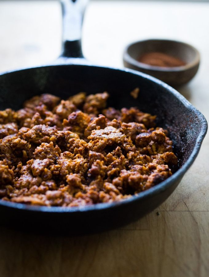 A simple and delicious recipe for Turkey Chorizo - a lightened up version of our favorite Mexican sausage. Can be made in 15 minutes! | www.feastingathome.com