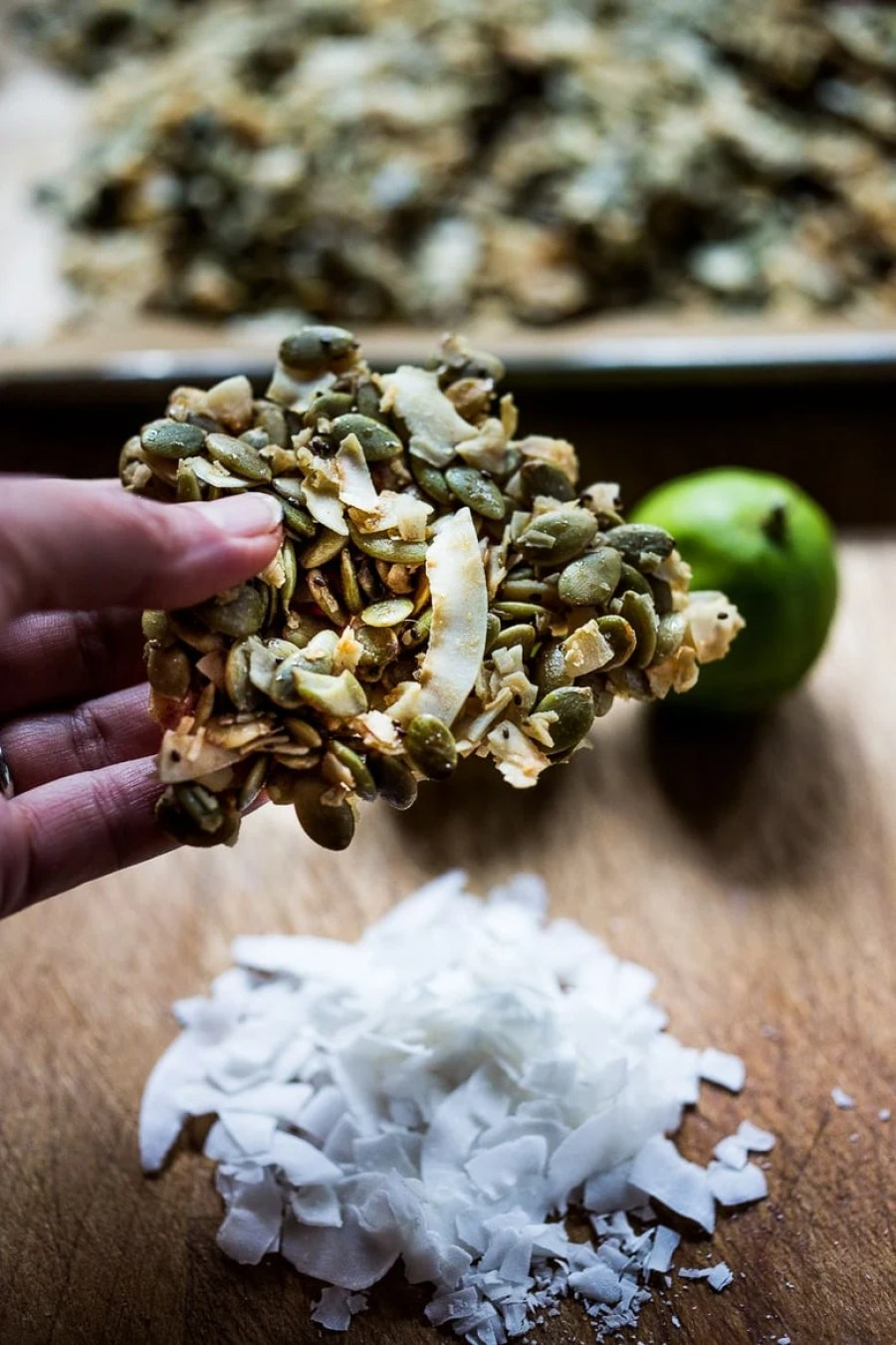 A simple recipe for Coconut Pumpkin Seed Snacks infused with lime and honey. Easy, delicious! Vegan and gluten free! | www.feastingathome.com