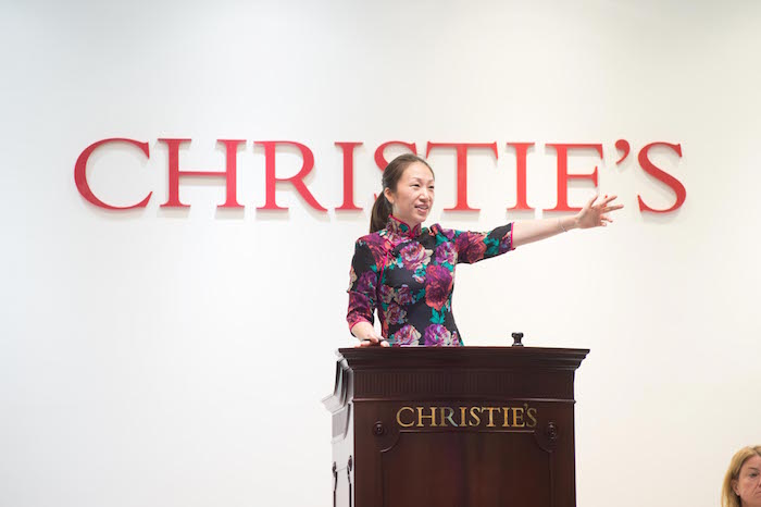 Elaine on the rostrum in a bespoke qipao