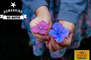 This is an image of two hands holding two flowers