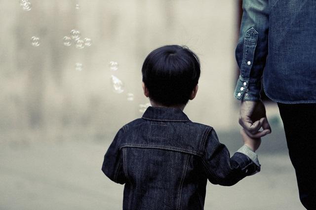 child parent holding hands
