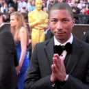 Pharrell Williams Praying in a Suit