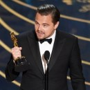 """Leonardo DiCaprio accepts the award for best actor in a leading role for """"The Revenant"""" at the Oscars on Sunday, Feb. 28, 2016, at the Dolby Theatre in Los Angeles. (Photo by Chris Pizzello/Invision/AP)"""