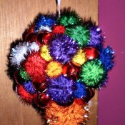 Making Jingly Pom Pom Christmas Ornaments with a Preschooler