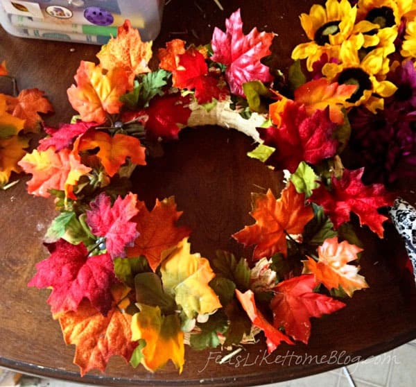Glue colored leaves on top of green leaves - Kids Fall Leaf Wreath