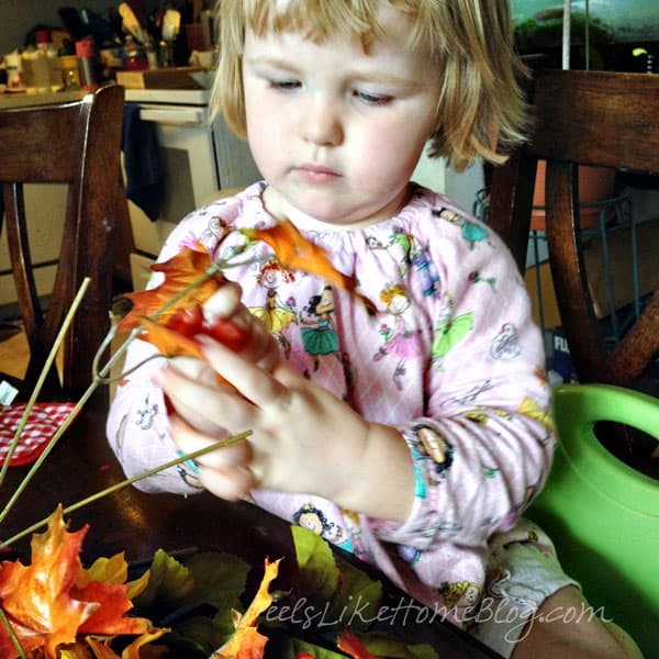 Remove flowers and leaves from plastic stems - Autumn Wreath Craft for Kids