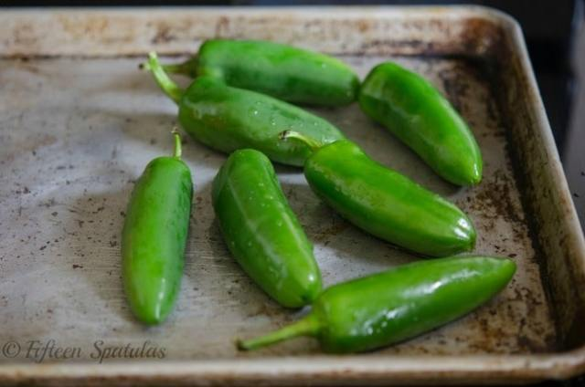 jalapenos on a roasting tray for cheese crackers