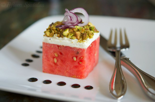 watermelon cube with goat cheese, pistachios, red onion, and balsamic