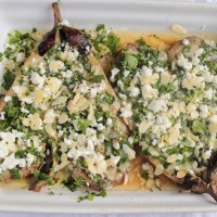 Aubergines with feta, lemon, parsley and almonds