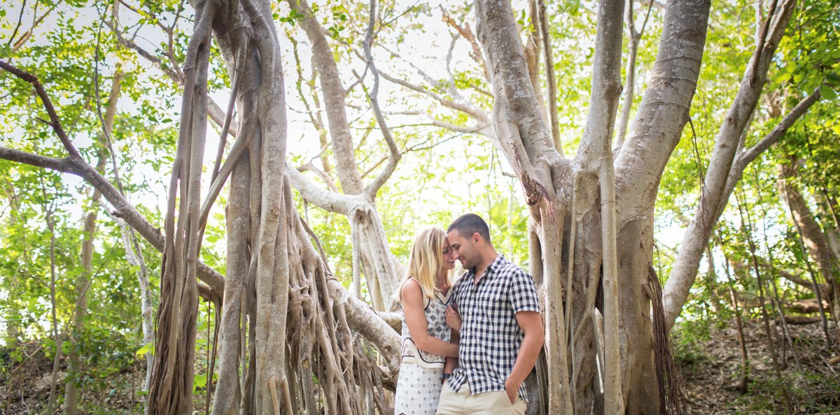 engaged couple snuggles during their photo session in key west florida