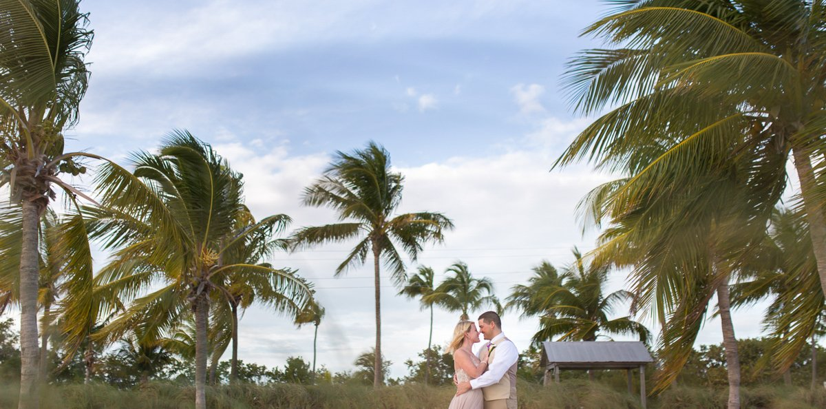couple with palm trees on key west beach
