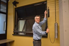 Rich opens customer service window with vintage chain and weight