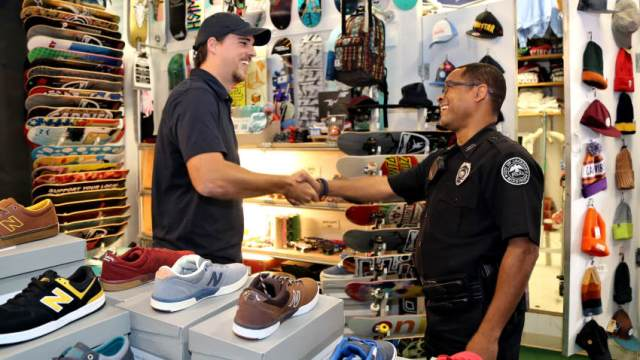 Swell-O-Phonic employee Chris Wooley gets a check-in from Officer Corey Whitlock during a routine patrol.