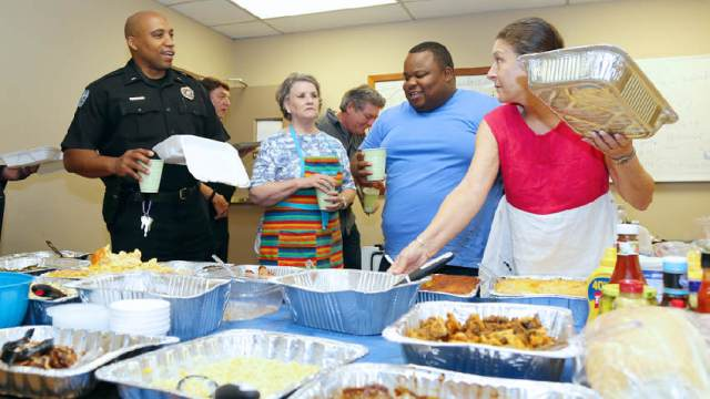 (L to r) lt. Alfred Cooper, Sarah Morris, Sgt. Larry Davis and Rhonda Blassingame at a community meal for JPD.