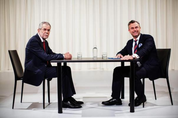Austrian right wing Freedom Party (FPOe) top candidate Norbert Hofer (R) and top candidate Alexander Van der Bellen, supported by The Greens, react ahead of a television debate in Vienna, Austria, 15 May, 2016. The presidential run-off vote will take place on 22 May 2016. ANSA /LISI NIESNER