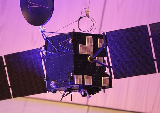A model of the space probe Rosetta is pictured at the headquarters of the European Space Operations Centre (ESOC) of the European Space Agency (ESA) in Darmstadt, western Germany, on September 30, 2016, the day of the controlled descent of the ESA space probe Rosetta onto the surface of Comet 67P/Churyumov-Gerasimenko. Europe's Rosetta spacecraft was headed for a mission-ending crash on the comet it has stalked for two years, a dramatic conclusion to a 12-year odyssey to demystify our Solar System's origins. / AFP PHOTO / DANIEL ROLAND