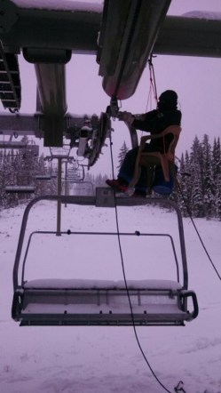 Employees work in snow to prep chairlifts for winter at White Pass, Wash. (photo: White Pass Resort)