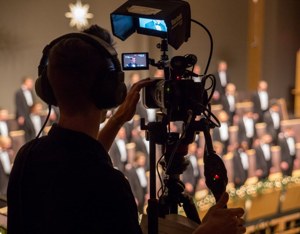 Student Benson Hostetter operates a camera during the taping of Festival of Carols.