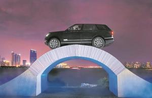 Range Rover Drive Over a Bridge of Paper