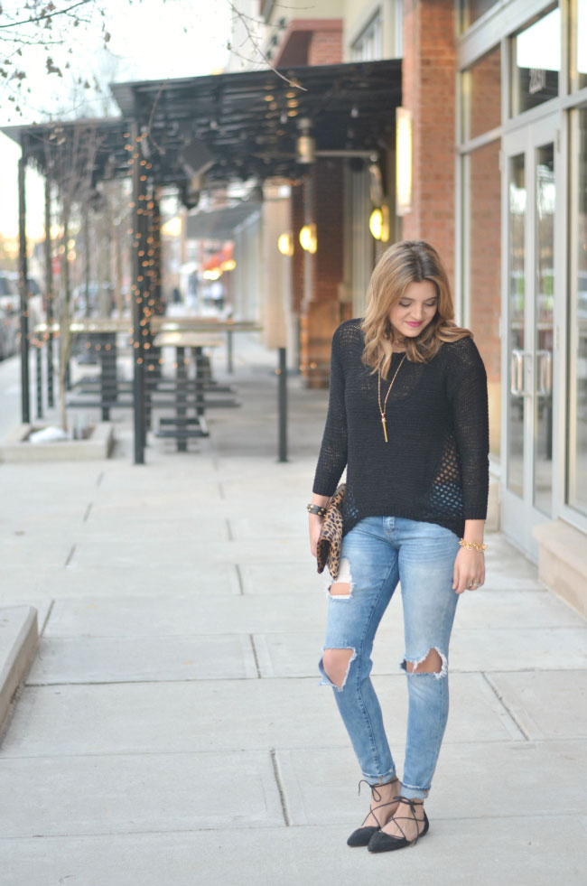 torn skinny jeans, black open knit sweater, lace up flats via fizzandfrosting.com